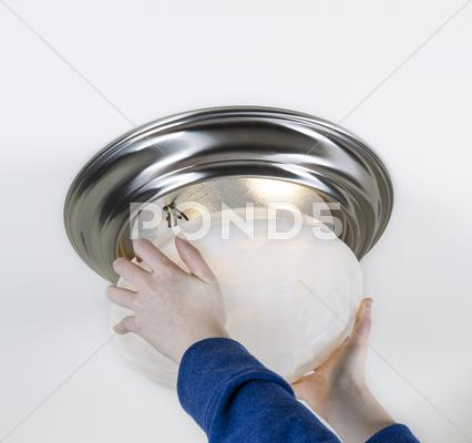 Stock photo of installing new light bulbs