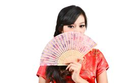 pretty women with chinese traditional dress cheongsam and hole chinese fan - stock photo