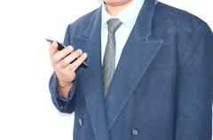 Flat cell phone in business man on white background Stock Photos