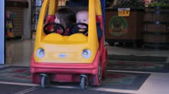 Kids in car shaped shopping cart. - stock footage