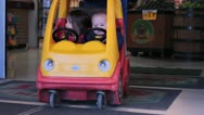 Stock Video Footage of Kids in car shaped shopping cart.