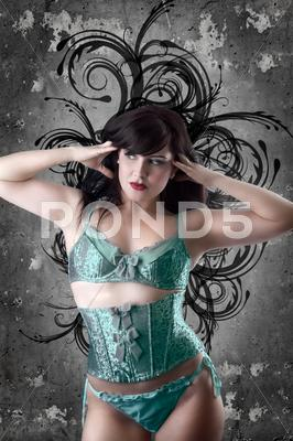 Stock photo of sexy woman with green lingerie over artistic background