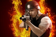 armed policeman shooting, isolated on white - stock photo