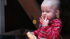 Small boy eating a donut. Stock Footage