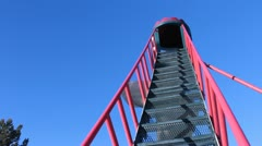 Little girl climbing stairs to go down a slide. Stock Footage