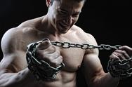 Stock Photo of the perfect male body - awesome bodybuilder posing