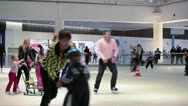 Children and parents skating in rink Stock Footage