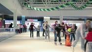 Skating people on rink insideob building Stock Footage