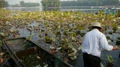 Vast lotus pool,Fisherman on wooden boat clean lake in beijing. Stock Footage
