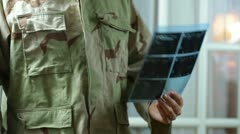 Soldier looking xray examine Stock Footage
