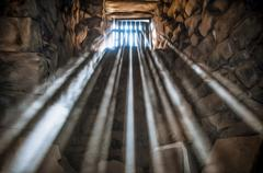 Stock Photo of jail cell with sun rays.