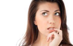 beautiful young woman thinking - stock photo