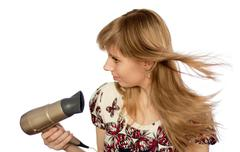 Girl with hairdryer Stock Photos