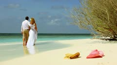 Boy And Girl Go On The Seashore. Stock Footage