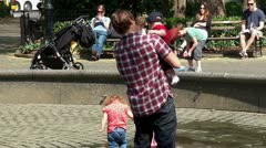 Children playing with his father in Madison Square Park. NYC, USA. Stock Footage