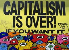 """""""capitalism is over! if you want it"""" text on a graffiti Stock Photos"""