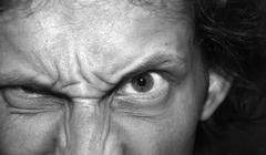 eyes of an angry man. - stock photo