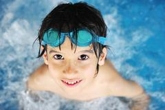 summertime and swimming activities for happy children on the pool - stock photo