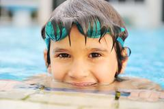 Summertime and swimming activities for happy children on the pool Stock Photos