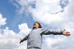 little boy feeling a freedom on meadow in nature - stock photo