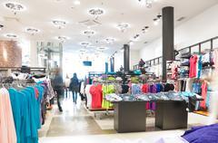 Modern clothes shop Stock Photos