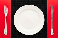 Empty plate with fork and knife Stock Photos