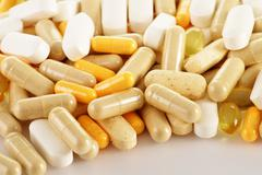 Composition with dietary supplement capsules. drug pills Stock Photos