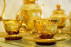 transparence gold hand-made tea-service - stock photo