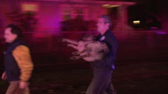 Dog being carried from a house fire Stock Footage