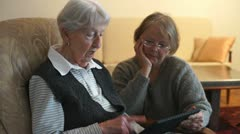 Adults with tablet - stock footage