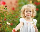 Child in garden Stock Photos