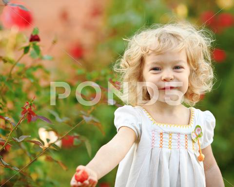 Stock photo of child in garden