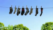 Stock Video Footage of laundry line with baby socks in the wind (HD)