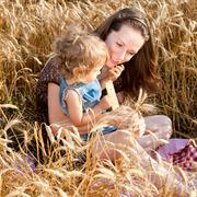 Woman and child in wheat field Stock Photos