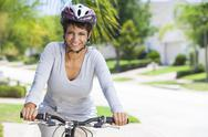 African american woman riding bike Stock Photos