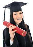 student girl in an academic gown, graduating and diploma - stock photo