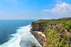 cliffs above the sea, nusa dua, bali, indonesia - stock photo