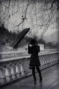 Young woman in coat with umbrella Stock Photos