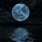 big blue moon reflected in water surface - stock photo
