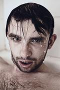 Wet face men in the shower Stock Photos