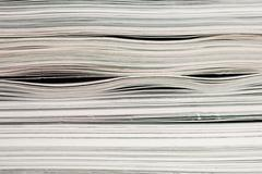 Side view of stack of papers, books, and magazines for recycling. Stock Photos