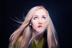 woman with hair fluttering in wind - stock photo