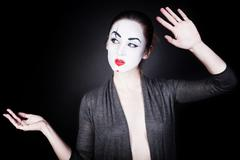 Woman in mime make-up dancing Stock Photos