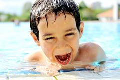 children activities in swimming pool - stock photo
