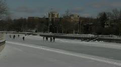 Ice Skaters on Frozen Waterway Stock Footage
