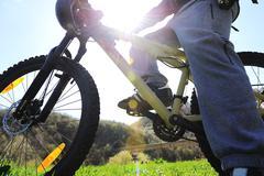 mountain biker in action, summer sunshine - stock photo