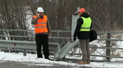 Engineer and road foreman near the bridge defence barriers Stock Footage