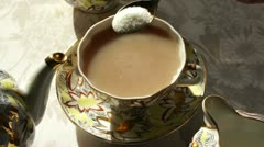 Tea with milk and sugar Stock Footage