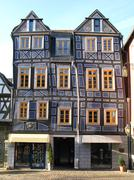 Sloping half-timbered House - stock photo