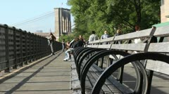 Tourists walk on the Brooklyn Heights Promenade - stock footage